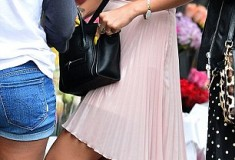 Rihanna in American Apparel Stretch Floral Lace Ruched Front Tube Bra pink Topshop Pleated Dip Back Skirt body chain yellow talon nails black Celine Nano Luggage Bag sunglasses black hi-top Converse Chuck Taylors