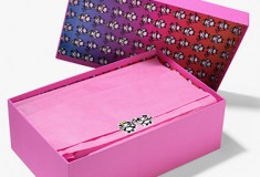Special Jimmy Choo packaging which includes pink dust bags and bright pink boxes with dégradé lining, sealed with an angel or devil panda sticker