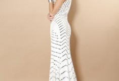 What she wore: Tessanne Chin in Jovani Prom Dress 6433 white halter gown with silver beading