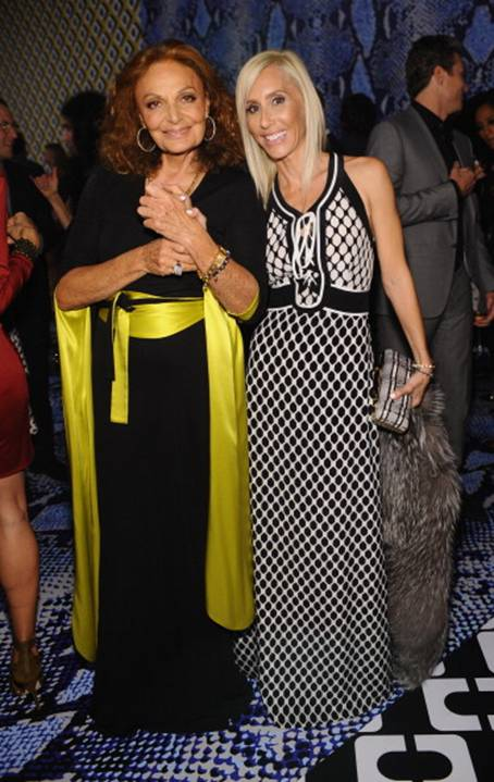 Diane von Furstenberg in a DVF Wrap Dress and Alexandra von Furstenberg in a DVF Dress and Tonda Clutch