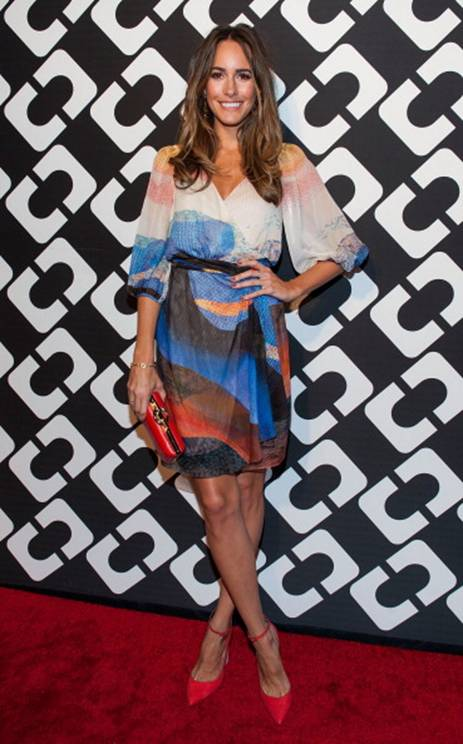 Louise Roe in a DVF Spring '14 Wrap Dress and Clutch