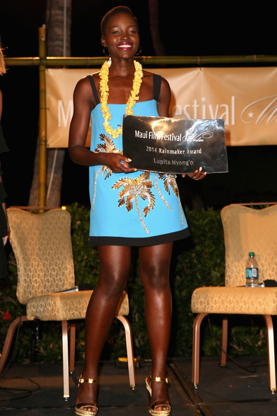 Lupita Nyong'o in Fausto Puglisi Spring/Summer 2014 palm dress receives the 2014 Maui Film Festival Rainmaker Award at the 2014 Maui Film Festival in Wailea
