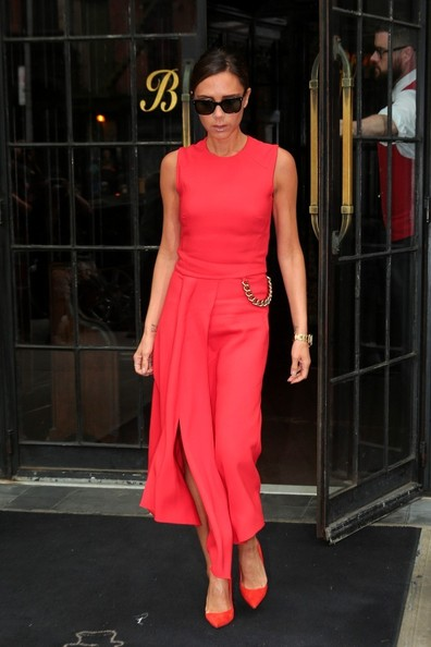 Victoria Beckham leaves her hotel in New York in red dress with gold chain