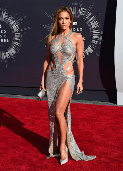 J. Lo Jennifer Lopez in a Charbel Zoe dress, Jimmy Choo pumps, Norman Silverman jewels and a silver python clutch