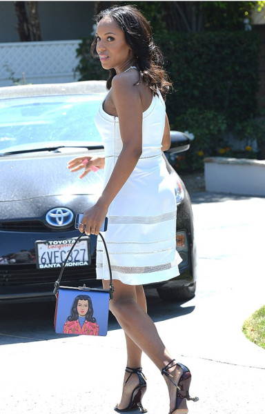 Kerry Washington in a white Parker Whitefield dress and Prada face print bag and Louis Vuitton Artifice Wedge curved heel Sandals