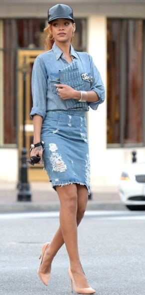 Rihanna in Current/Elliott The Perfect Shirt with Acne's Fine Trash Distressed Denim Skirt, black leather baseball cap, a Juliette Jake Wrap Around Clutch in light blue, cuff bracelets, nude Céline pumps and a vintage Chanel pearl brooch