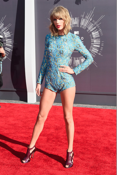 Taylor Swift in a Mary Katrantzou romper and Elie Saab shoes