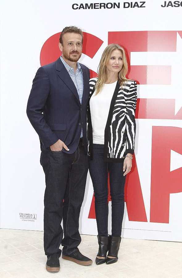 Jason Segel with Cameron Diaz in Balmain Zebra-patterned jacquard-knit cardigan