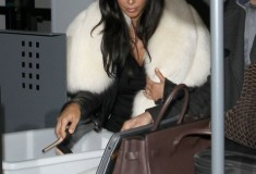 Kim Kardashian with large white fur scarf 2