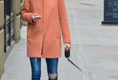 Olivia Palermo in a melon-colored pastel coat