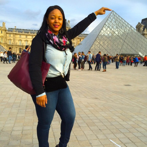 Wearing a chambray shirt and jeans at the Louvre  in Paris