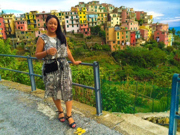 Wearing a printed sundress from & Other Stories in Cinque Terre