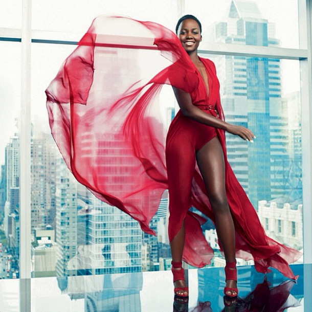 Lupita Nyong'o in Paris Match Magazine in a red bodysuit/gown/cape