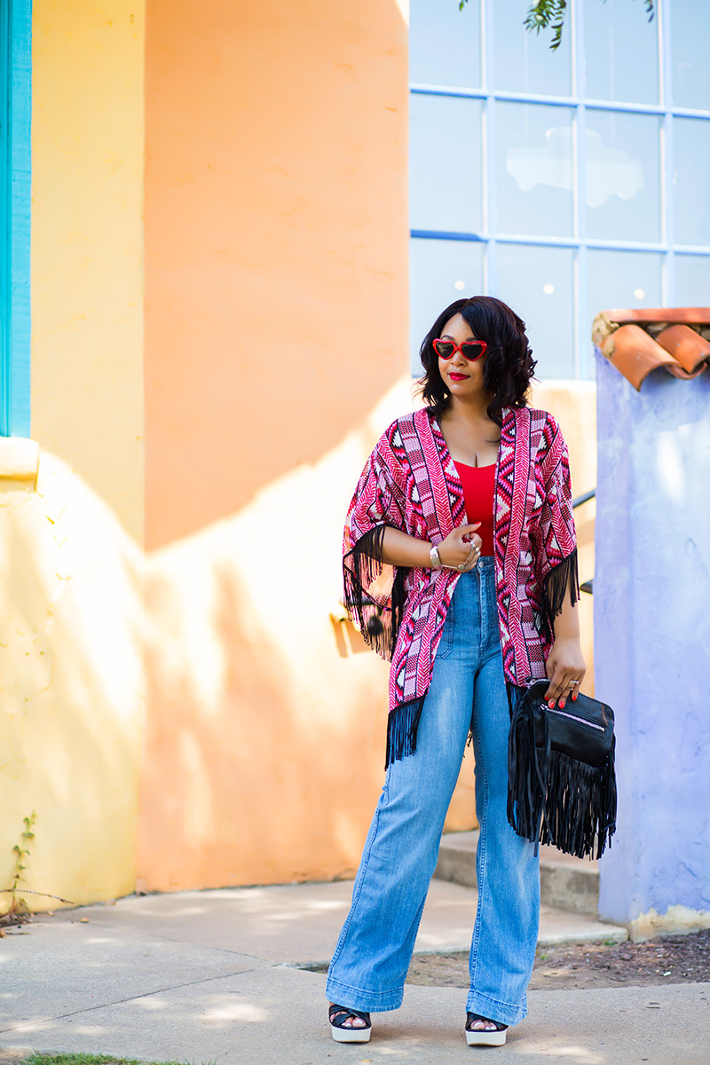 12 Ways to Wear Denim and get the look: Wide-Leg Jeans, 70's style, 70's inspired fashion, Heart-shaped sunglasses, Fringe Kimono, Crop top, H&M High waist Wide-leg Jeans, Corso Como Nani Wedges, Linea Pelle Janis Fringe Leather Clutch, My style