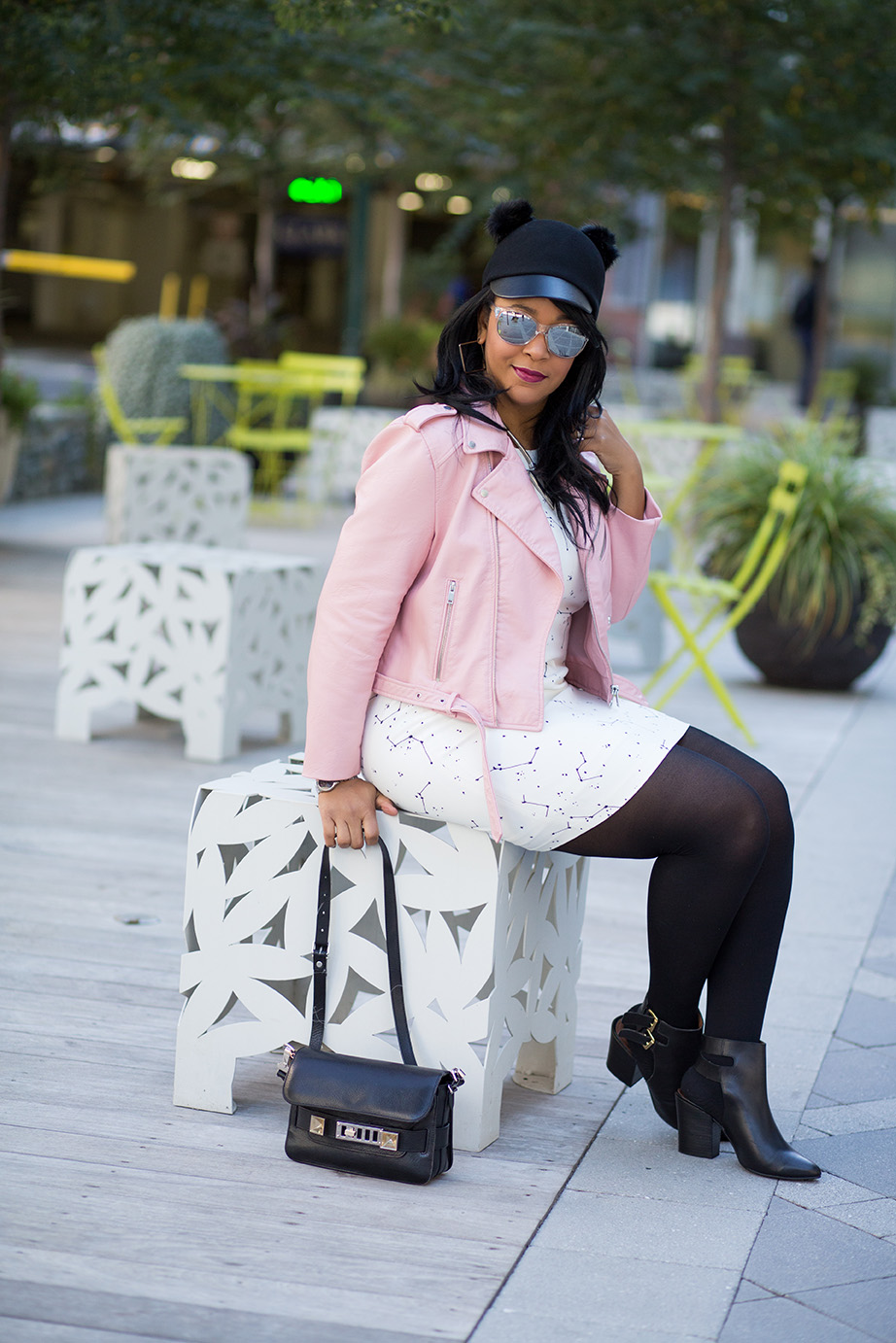 For the Love of Moto Jackets: Here's what I'm wearing: Mirrored sunglasses, H&M Wool Hat with faux fur bunny ears, Zara Constellation Print Dress, Zara Pink Moto Jacket, Hue opaque tights, Shoemint Slingback Booties, Proenza Schouler PS11 bag