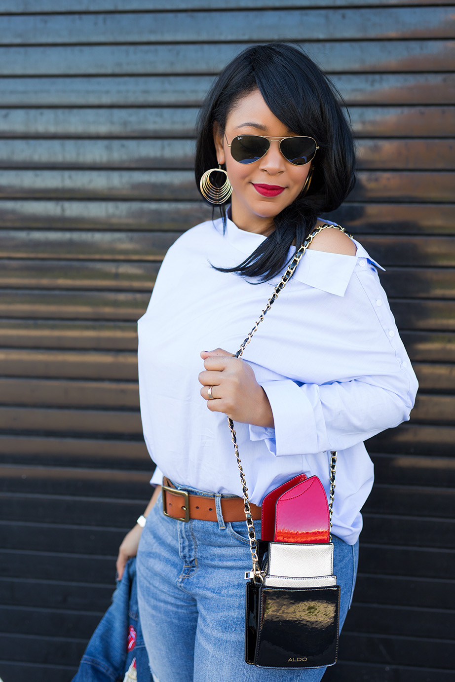Finding fun this February - What I'm Wearing: charming Charlie Waved Layer Dangle Earrings, Zara Blouse with Asymmetric Neckline, Who What Wear collection Raw Edge Denim Jacket, Mossimo High-rise Skinny Jeans, Topshop Gold Mules Aldo Portland Lipstick bag