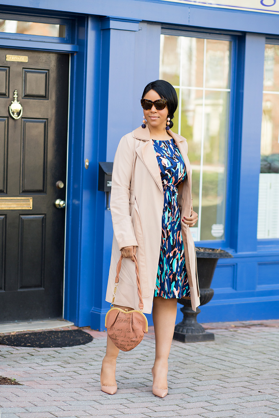 Women Who Work - What I'm Wearing: House of Harlow 1960 Chelsea Sunglasses - Tortoise, Leota Ilana dress in 'Mambo', Rachel Roy Reversible Trench Coat Dress, Christian Louboutin Pigalle Pumps, John Galliano Tan Leather Heart Shoulder Bag, BaubleBar Crispin Drop Earrings in Multi