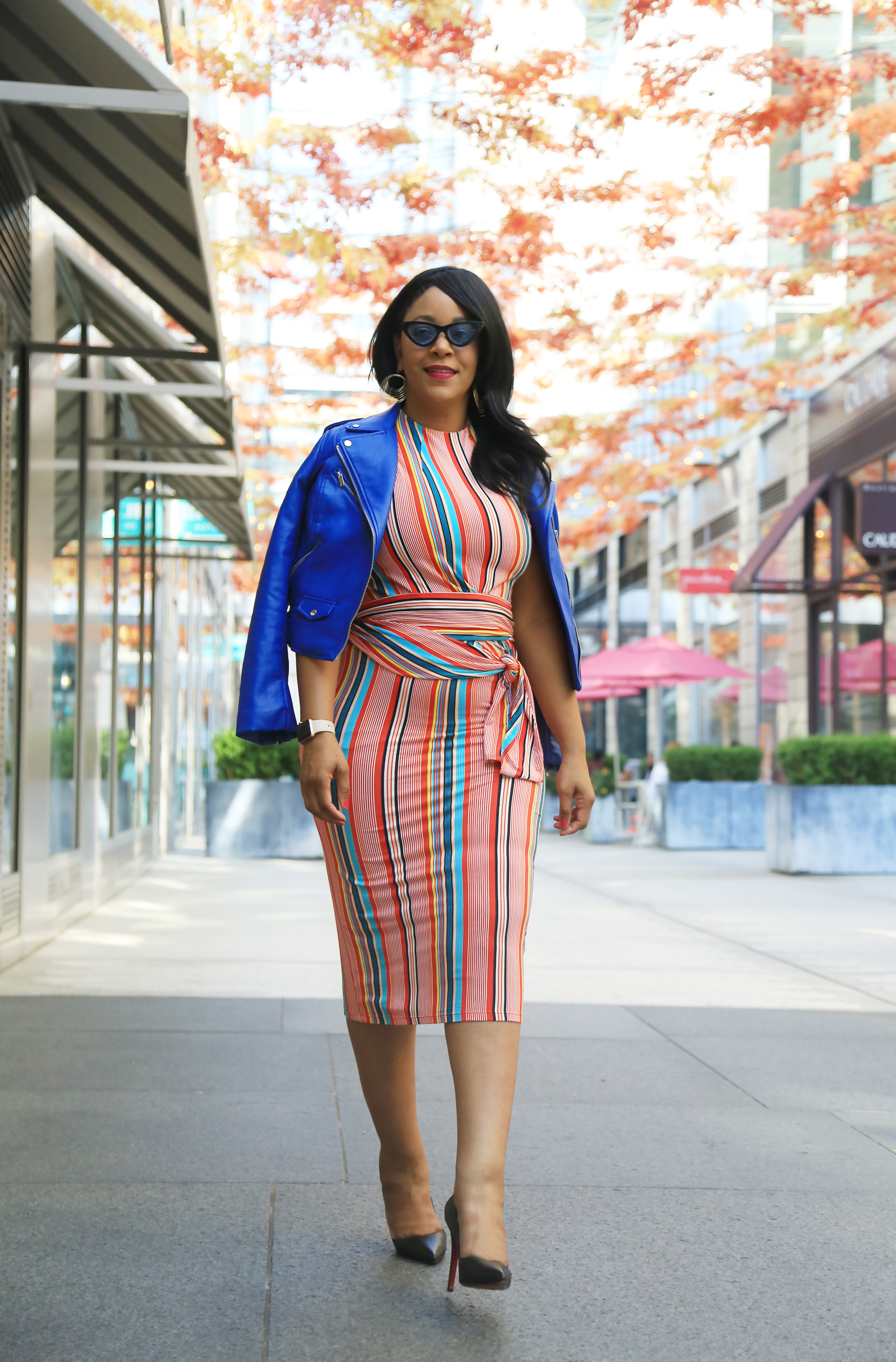 Goals Check In: Tackle Your Remaining 2019 Goals with These 3 Tips! Outfit details: Alice + Olivia - Delora Sleeveless Tie Waist Stripe Dress, Zara blue faux leather moto jacket, Christian Louboutin Pigalle pumps