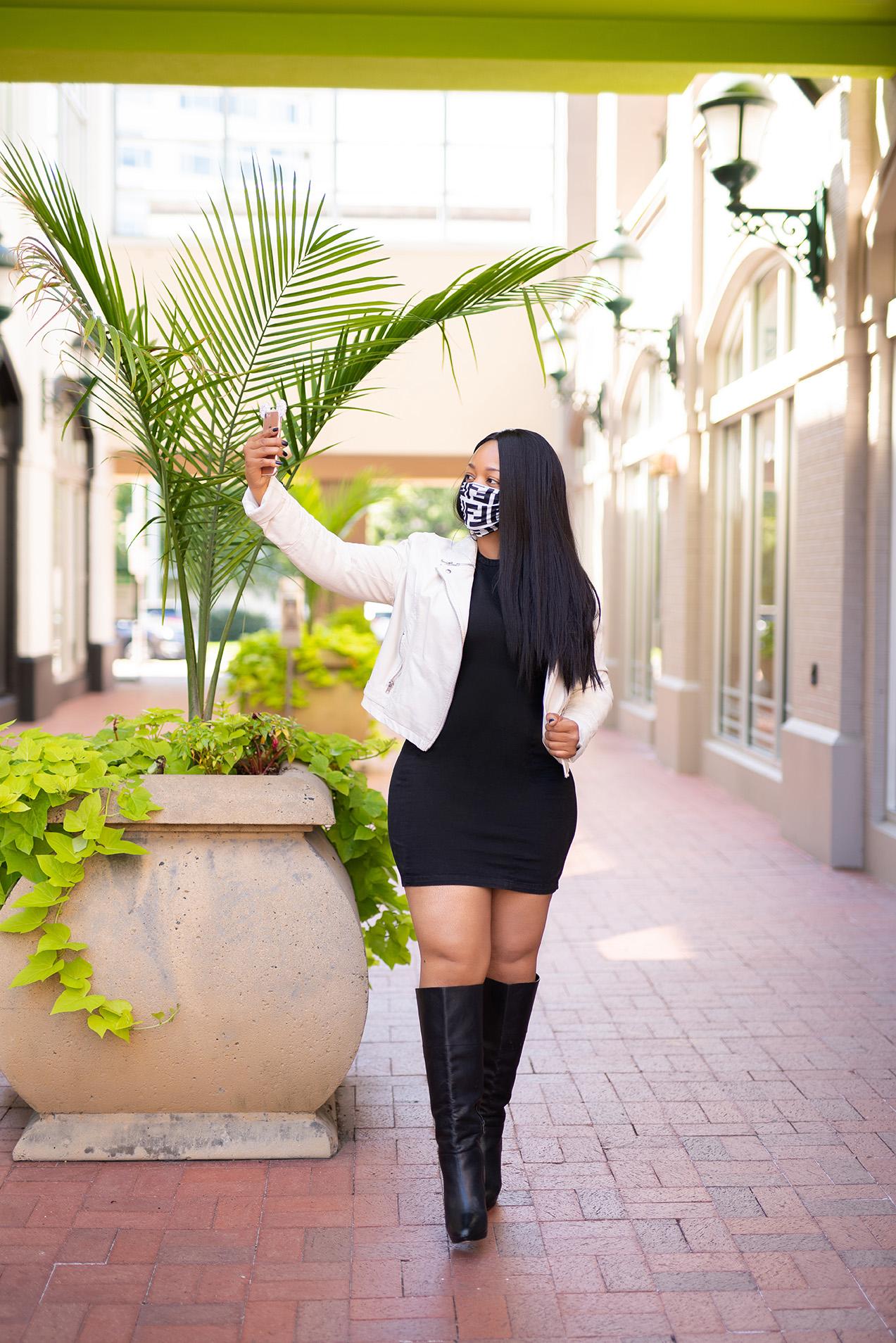 What's Haute, hot masked summer, off white leather biker jacket, black denim dress, black leather knee high boots, designer print face mask
