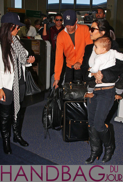 Kim Kardashian JFK airport was spotted toting her black Hermes Birkin Kourtney Kardashian carrying baby Mason Dash Scott Disick tried to manage her Balenciaga bag