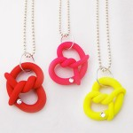 onchmovement-pretzel-necklaces-in-pink-red-yellow