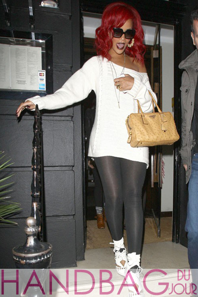 Rihanna jetsets to London in Prada ostrich satchel and Nicholas Kirkwood for Rodarte melted heels