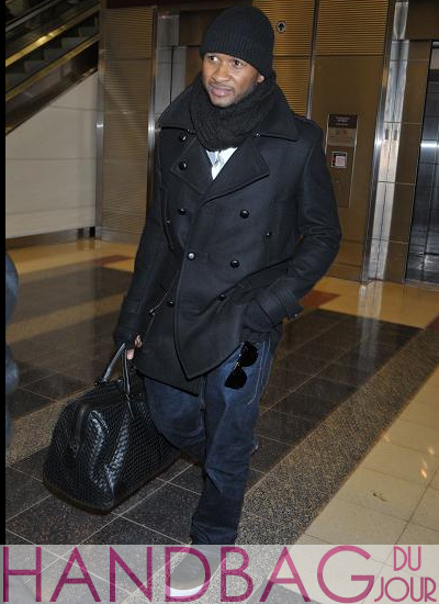 usher-with-bottega-veneta-nero-intrecciato-large-duffel-bag