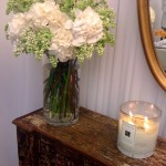 Rachel Roy showroom flowers candle