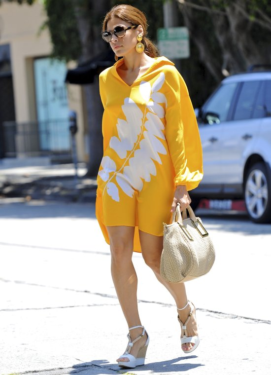 Eva Mendes in Los Angeles, California, wearing a yellow tunic dress with a white leaf print, Chloe Braided T-Strap Ankle Strap Wedges in Dune and the Chloé Ethel Top Handle Satchel