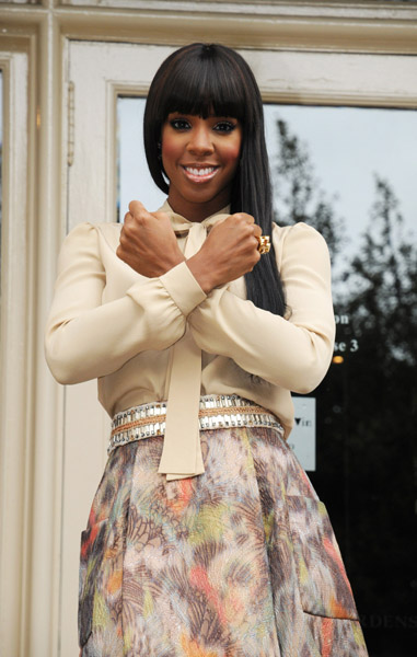 Get-her-haute-look-Kelly-Rowland Chloé tie neck blouse, Brown's Fashion, Yves Saint Laurent Arty gold-plated flower ring, Net-a-Porter Fendi Liberty cutout platform pumps, Farfetch.com Matthew Williamson box pleat skirt, Selfridges X Factor UK auditions