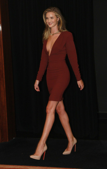 Rosie Huntington-Whiteley in Stella McCartney 2011 deep V crepe burgundy dress to a Berlin press conference for her new movie Transformers
