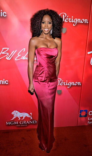 "Kelly Rowland was seen in Vegas celebrating Muhammad Ali's 70th birthday at the Keep Memory Alive Foundation's ""Power of Love Gala"", wearing a fuchsia strapless satin gown by Alberta Ferretti"