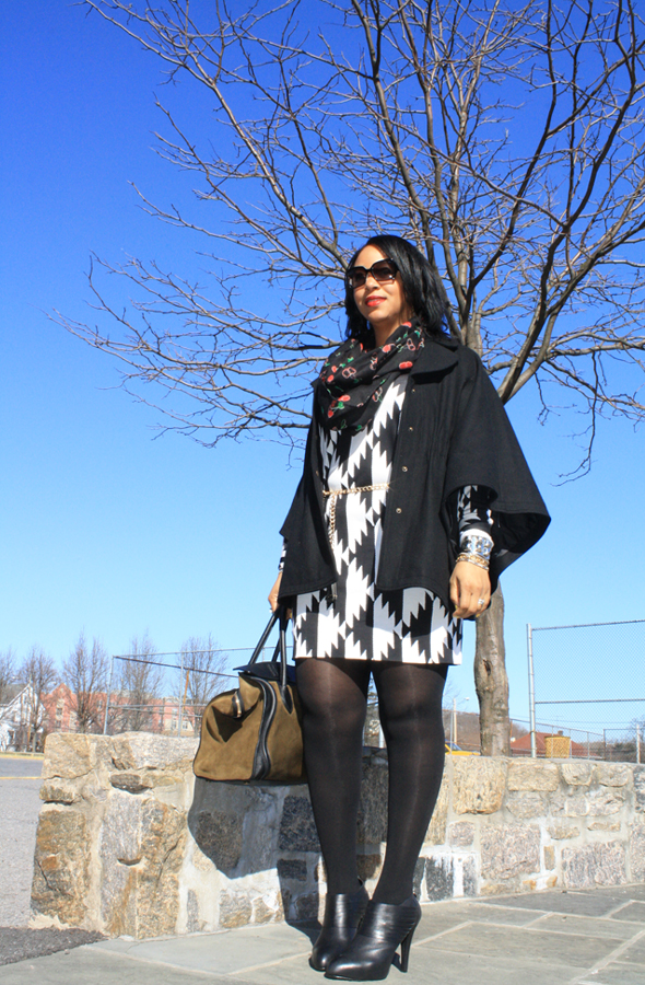 Hilary Radley wool cape, H&M cherry print infinity scarf, Fendi sunglasses, Diane von Furstenberg black and white print dress, Zara chain and tassel belt, No More Muffin Top tights, Max Studio booties, Celine suede and leather luggage tote