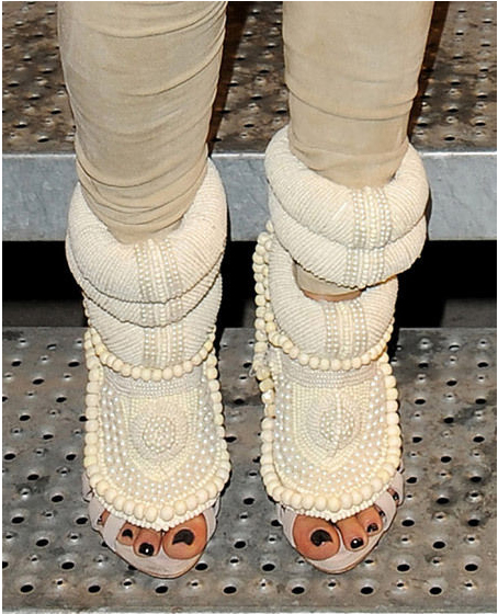 3a6bd56ce3027 Kim Kardashian in Kanye West for Guiseppe Zanotti heels - Paris Fashion Week