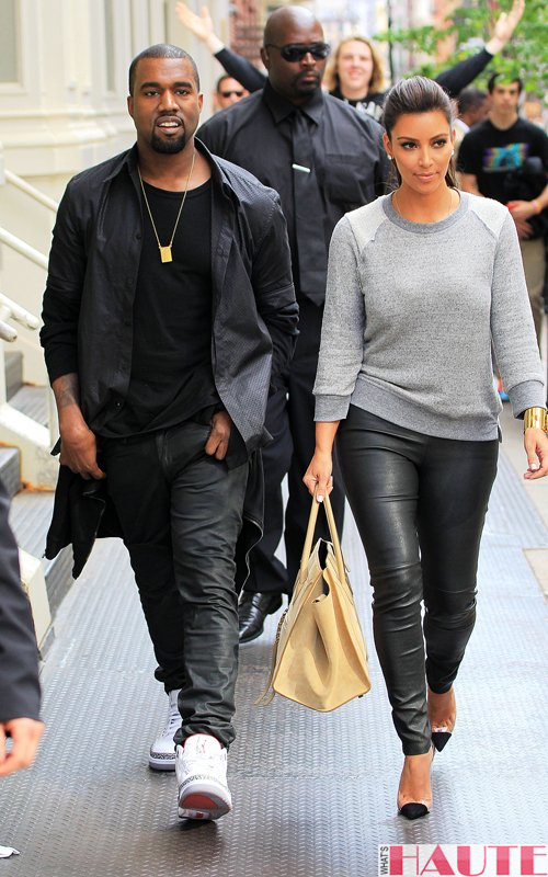 Kanye West and Kim Kardashian in grey 194t Crop Sweatshirt with Reverse Raglan Celine taupe leather 'Luggage Phantom' square tote leather leggings Christian Louboutin Unbout Illusion Slingback pumps