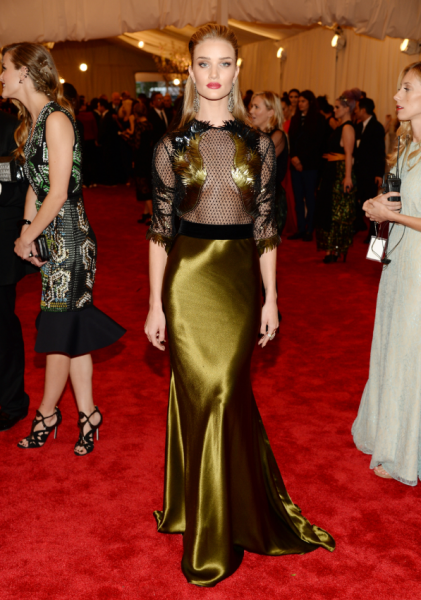 Rosie Huntington-Whiteley in a Gucci black and gold gown