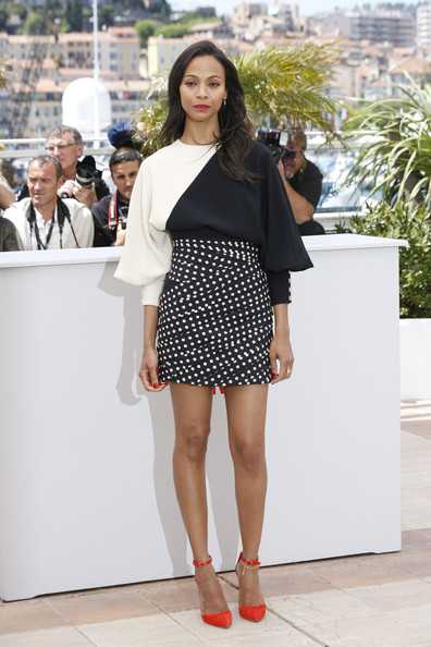 Zoe Saldana in black and white Emanuel Ungaro Fall 2013 and Oscar Tiye red open pumps with ankle strap at the photocall for 'Blood Ties' at the 66th Annual Cannes Film Festival