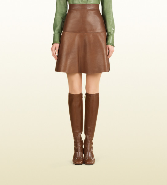 lively in gucci leather ruffle shirt and skirt