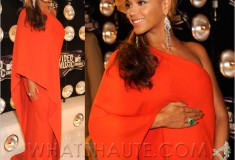 Beyonce draped in an orange Lanvin dress, diamonds and emeralds on the 2011 MTV Video Music Awards' white carpet showing off her baby bump – yes, she's pregnant!