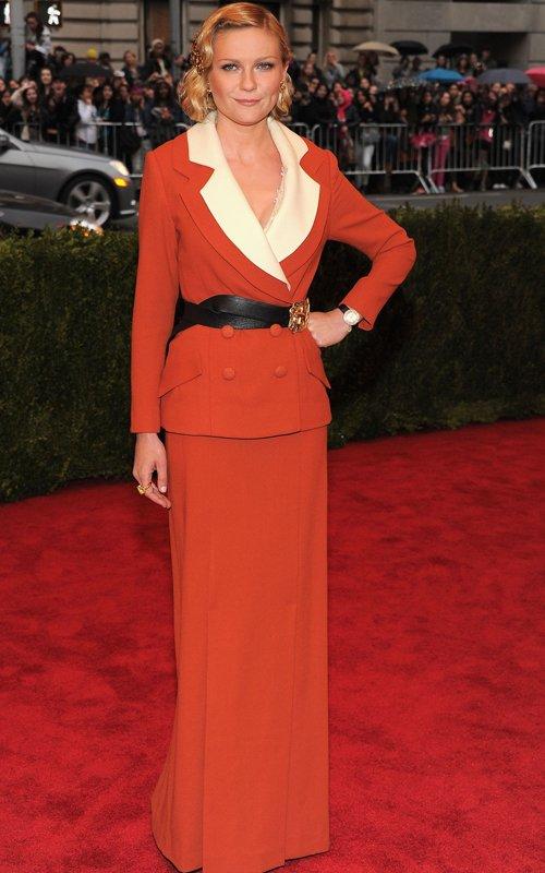 MET Gala 2012 Kirsten Dunst in orange suit