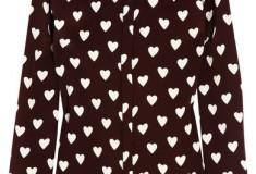 What she wore: Victoria Beckham in Burberry Prorsum's Heart-print silk-crepe shirt