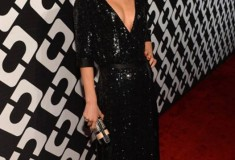 Elizabeth Gilpin in a DVF Embellished Wrap Gown and Tonda Clutch
